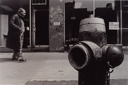 Street Photograph: Man walking by afire hydrant.