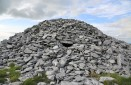 """""""Turlough"""" is gaelic for """"vanishing lake,"""" a distinctively ephemeral feature of The Burren's limestone landscape. Sitting proudly atop Turlough Hill lies this ancient cairn, retaining the marks of untold numbers who lay their loved ones to rest beneath the stones."""